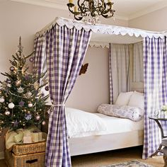 Beautiful guest room with purple gingham bed curtains and a tabletop tree