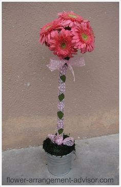 Baby Shower Floral Arrangements Centerpieces | This is a topiary table centerpiece for a baby shower party. I used ...