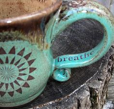 The search for a mug continues!  This is lovely.  http://www.etsy.com/listing/80478401/handmade-pottery-mug-made-to-order