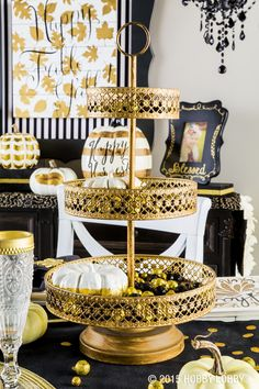 Display your favorite Fall decor or put delicious holiday treats on display with this gorgeous three-tiered golden tray.