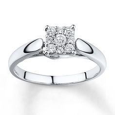 A chorus of round diamonds sparkles in sweet harmony at the center of this lovely engagement ring for her. The ring, styled in 10K white gold, has a total diamond weight of 1/4 carat. Diamond Total Carat Weight may range from .23 - .28 carats.