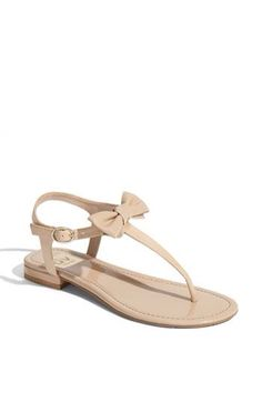 These shoes are super cute! Light brown, nude color with a bow on top!