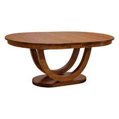 """This elegant 54"""" x 72"""" Oval table is skillfully constructed in the United States by the Amish Craftsmen with Solid Quartersawn White Oak (shown). You can take pride in owning furniture built to the highest standards with the strictest attention to detail. This gracefully defined table have a double U shaped curved with an oval base is perfectly proportioned to complete a classic Art deco design. It also have a self storing feature up to four leaves with a rack and pinion mechanism on…"""