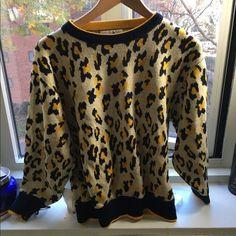 ⛄️Sale⛄️Leopard hipster sweater *vintage Vintage leopard sweater. Worn gently. Vintage Sweaters