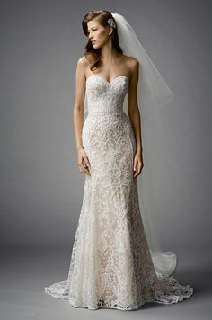 Beautiful strapless wedding dress with unique lace details. Check out the fabulous Watters Fall 2015 bridal collection: