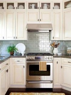 Do you have a small kitchen space? Try adding glass shimmering tiles to open the space up. by corrine