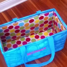 She took a vinyl tablecloth (the kind you can get at Walmart or dollar tree) and some pieces of cardboard. She wrapped the cardboard with the tablecloth and made sides and a bottom. Now her bag stays upright at all times. Reminds me of baby bed bumper pads. Great idea!