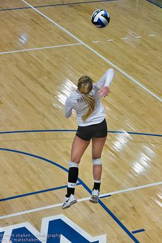 Dimensions of a Volleyball Court: Player Serving Behind The White Service Line (photo Mark Shaiken)