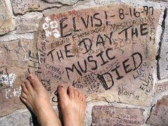 This is the brick wall that surrounds the front of Graceland. Ive signed my name once.!!!