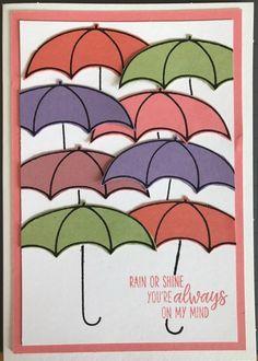 Dit prachtige paraplu kaartje is gemaakt door Sirpa van der Heijden. Ze heeft de verschillende kleuren kaartkarton van de combinatie gebruikt en daar met zwarte inkt op gestempeld. Door het te matten op een laag Flirty Flamingo kaartkarton blijft het een hele vrolijke kaart. Goed gedaan, Sirpa! Mooi voorbeeld.