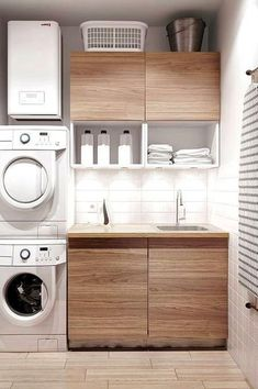 A small laundry room can be a challenge to keep laundry room cabinets functional, yet since this laundry room organization space is constantly in use, we have some inspiring design laundry room ideas. White Laundry Rooms, Modern Laundry Rooms, Laundry Room Layouts, Laundry Room Cabinets, Basement Laundry, Laundry Room Organization, Wood Cabinets, Laundry Shelves, Laundry Closet