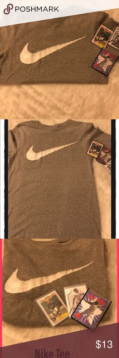 """EUC Men's Nike Tee grey in M This shirt is like new. No damage, tears , stains. Washed once and hung to dry. It's grey either grey and white swoosh 🏈🎾⚾️🏀⚽️🏐🏉 Great staple for the Nike lover. Could be uni sex. It measures 18"""" arm pit to arm pit and 26"""" long. Nike Shirts Tees - Short Sleeve"""