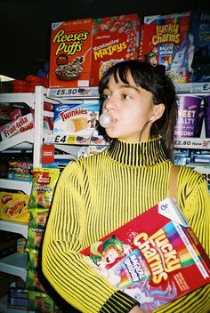 Grocery Shopping by Haley Canter | @haley.canter  #lucky charms #cereal #american #food #groceries #shopping #35mm #film #photography #shop #munchies #eat #retro #vintage #color #bright #yellow #fruit #chips #eating #girl #girls #fashion #indie #hipster #bangs #fringe #brunette #shop #store #grocers #buying #good