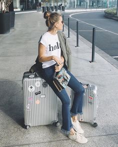 Airport life.  @rimowa_official #rimowa_official (wearing @abicycletteofficial t-shirt x denim)