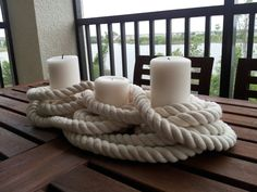 Very cool nautical centerpiece idea with candles and rope. Could definitely see us making this with Candle Impressions Flameless Candles! Wonder where one can find that kind of rope. Nautical Bridal Showers, Nautical Wedding Theme, Nautical Party, Nautical Food, Anchor Wedding, Nautical Centerpiece, Candle Centerpieces, Summer Centerpieces, Home And Deco