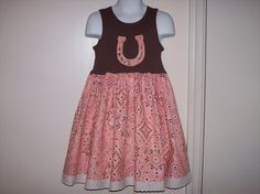 Horseshoe Applique Cowgirl Pink and Brown Bandana Fabric FARM T-shirt Dress size 12 mo 18 mo 24 mo 2T 3T 4T 5T 6X. $34.99, via Etsy.