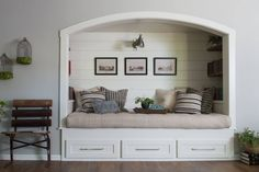 In the living room is where we created this one of a kind reading nook. It's almost like a little daybed with built in bookshelves for this family of readers to put to good use.