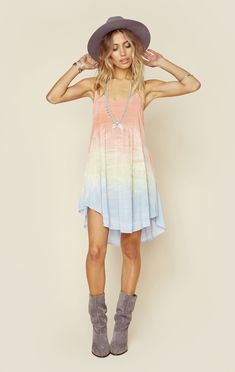 The Desert Dancer Dress by Blue Life features a hand tie dyed rayon fabrication, skinny straps and scoop neck, lace up detailing in the back, and a slightly ruffled flounce skirt.