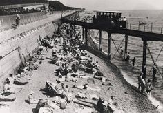 Some packed beaches in Brighton & Hove this weekend. Here's a busy beach from the early 1930s, with sun seekers gathered beneath the track of the Volk's Railway.