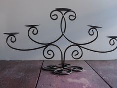 Candle Holder Vintage Candelabra, Five SconceWrought Iron Candle Holder, Rustic Pillar Candle Holder by used2bnewVintage on Etsy https://www.etsy.com/listing/218296433/candle-holder-vintage-candelabra-five