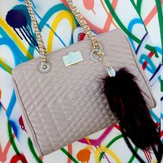 """Naomi quilted chain satchel with a faux fox tail charm is a versatile investment piece.  Shop quality vegan leather handbags at 88-eightyeight.com and available on Amazon, Faux for tail is exclusive to our website """"88handbags"""""""