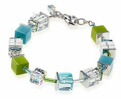 Swarovski Crystal. Polaris & Glass Cube Bracelet in Kiwi & Aqua; Stainless Steel and Silver Plated Rosselini. $95.00. Handmade in Germany by Rosselini/Coeur de Lion. Stainless Steel Plate Discs & Silver Plated Chain & Clasp. The Length is Adjustable from 7 Inches to 7 1/2 Inches. Has a Matching Necklace & Earrings Avaailable. Aqua, Green & Clear Swarovski Crystal Cubes with Matching Opaque Glass Cubes; Square Swarovski Crystal Rondells seperated by Glass Tubes