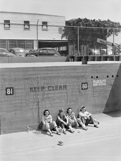 Lunchtime for four female workers at the Vega aircraft plant in Burbank, California (August 1943)