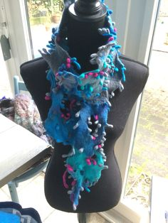 How nice and colourfull this felted scarf. Www.fabricias.nl