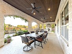 The perfect party porch! Love the Tuscan flair and the archways. #porch #patio