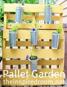 Bight and cheery Pallet Garden Wall created by Melissa via The Inspired Room