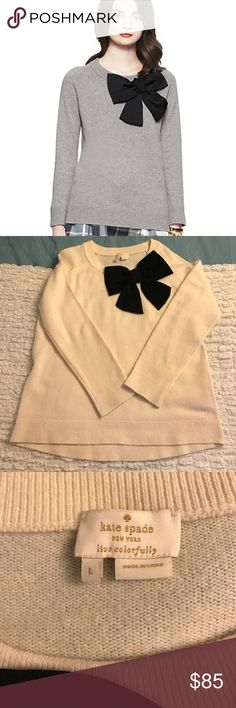 Kate Spade Bow Sweater I am actually selling the cream version of this sweater. It's from the Fall 2015 collection. Super comfy and warm. 100% wool. There is a very faint small light brown stain next to the bow, but not noticeable to the naked eye. Light pilling as well, but otherwise in great shape. kate spade Sweaters