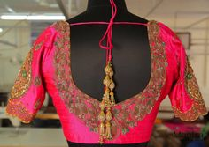 Lovely pink color designer blouse with floret lata hand embroidery thread work. 05 August 2017