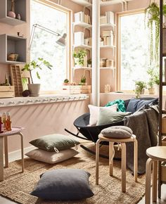 In a relaxing living room, low seating can be made from a mix of cushions, stackable stools and a bowl-shaped rocking chair from IKEA. The mix lets everyone choose how they like to sit. Don't forget a rug, too, like LOHALS in flatwoven jute.
