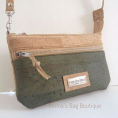 My second Small Essentials Cork Bag. I used some olive green and natural cork leather. It can be used as a hand clutch, with wrist strap or crossbody strap. It has one exterior zipper pocket, one interior zipper pocket and a couple of cards pocket. .