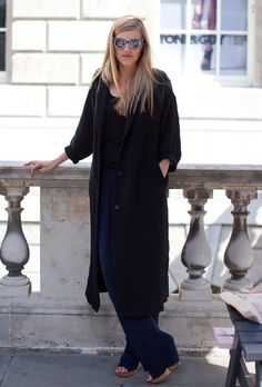 Long black coat.