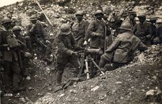 Italian soldiers examine a captured Austrian Maxim gun during the Seventh Battle of the Isonzo.