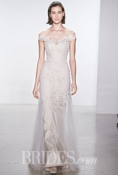 Brides.com: . Corded lace sheath wedding dress with an illusion high neckline and cap sleeves, Christos