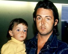 Paul McCartney poses with his daughter Mary in 1971.