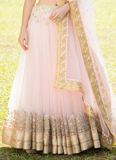 Cream and Light Pink Embroidered Net Lehenga features a dhupioni silk blouse, net lehenga with santoon inner and embroidered net dupatta. Zari, stone and sequins embellishments are present all over. Pink Lehenga, Net Lehenga, Bridal Lehenga Choli, Ghagra Choli, Lehenga Designs, Kurta Designs, Saree Blouse Designs, Lengha Design, Indian Dresses