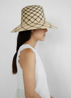 Hat Hair: Simple low pony. | blueberrymodern:  clyde spring 2014 via Her New Tribe