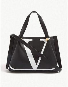 Valentino 'V' logo leather mini shopper Valentino Clothing, Valentino Shoes, Valentino Garavani, Valentino Handbags, Dolce And Gabbana Handbags, Selfridges & Co, Fashion Handbags, Purses And Bags, Crossbody Bag