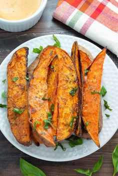 Golden, crunchy, and crisp sweet potato wedges are easy to make at home! When it comes to real meals, our weekday menu is nothing fancy. Most nights I'm so exhausted from baking all day I just want to plop down on the couch, turn on the tube, and order take-out. Most nights I fight that...