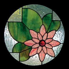 This Water Lily stained glass pattern is a favourite. Its easy to switch out the colour scheme and change it completely (maybe a yellow flower on dark blue water). The pale blue background in this picture is Noogie, an art glass from Optimum Studios. It looks like water droplets on the glass, very pretty.  14 round  32 pieces  level of difficulty beginner  materials list and colour photo included  grinder required Download the pattern PDF after purchase!