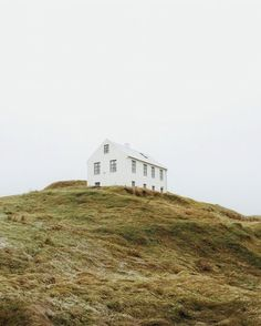 The rough and broad, bare landscape are simplicity at its finest. You will see a lot of these houses almost standing alone on hills and in the valleys in Iceland, and the sights are moving. Wonder if they ever feel alone?