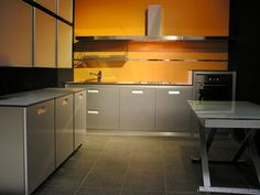 #Kitchen Idea of the Day: Modern Gray Kitchen with orange walls.