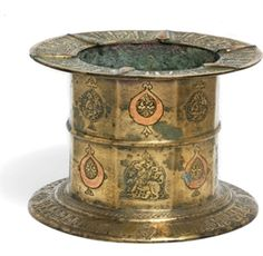 A LARGE KHORASSAN COPPERINLAID BRONZE MORTAR NORTH EAST IRAN, 12TH CENTURY. Price Realized £5,000 ($7,670)