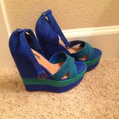 Blue wedges H by Halston. Size 6 Super hot blue wedges. H by Halston brand. Worn once see signs of wear in pics. Small black spot on inside of left shoe (see last pic). Blue ankle strap shown is removable. No box but can send dust bag upon request. H by Halston Shoes