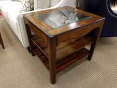 We have a select few of these solid wood end tables with glass tops. They retail originally for $279, now priced here for only $149!