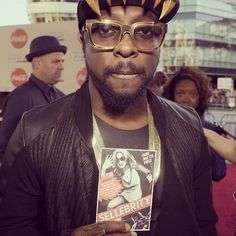 Spotted on the Red Carpet:  $ellebrity fan, Will.i.am! Red Carpet, Fan, Celebrities, Celebs, Hand Fan, Fans, Celebrity, Famous People