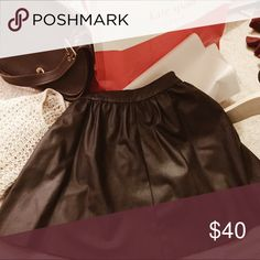 Topshop Faux Leather Skater Skirt Chocolate brown color. EUC. Visible dull brass zipper in back. Effortless chic! Topshop Skirts Circle & Skater